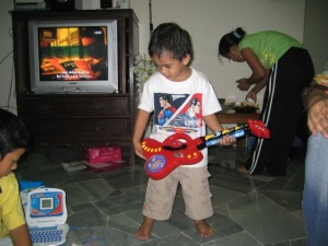 With his faux guitar