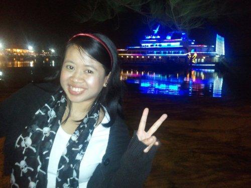 Ijah at the Danga Bay Marina, against a backdrop of the cruise ship